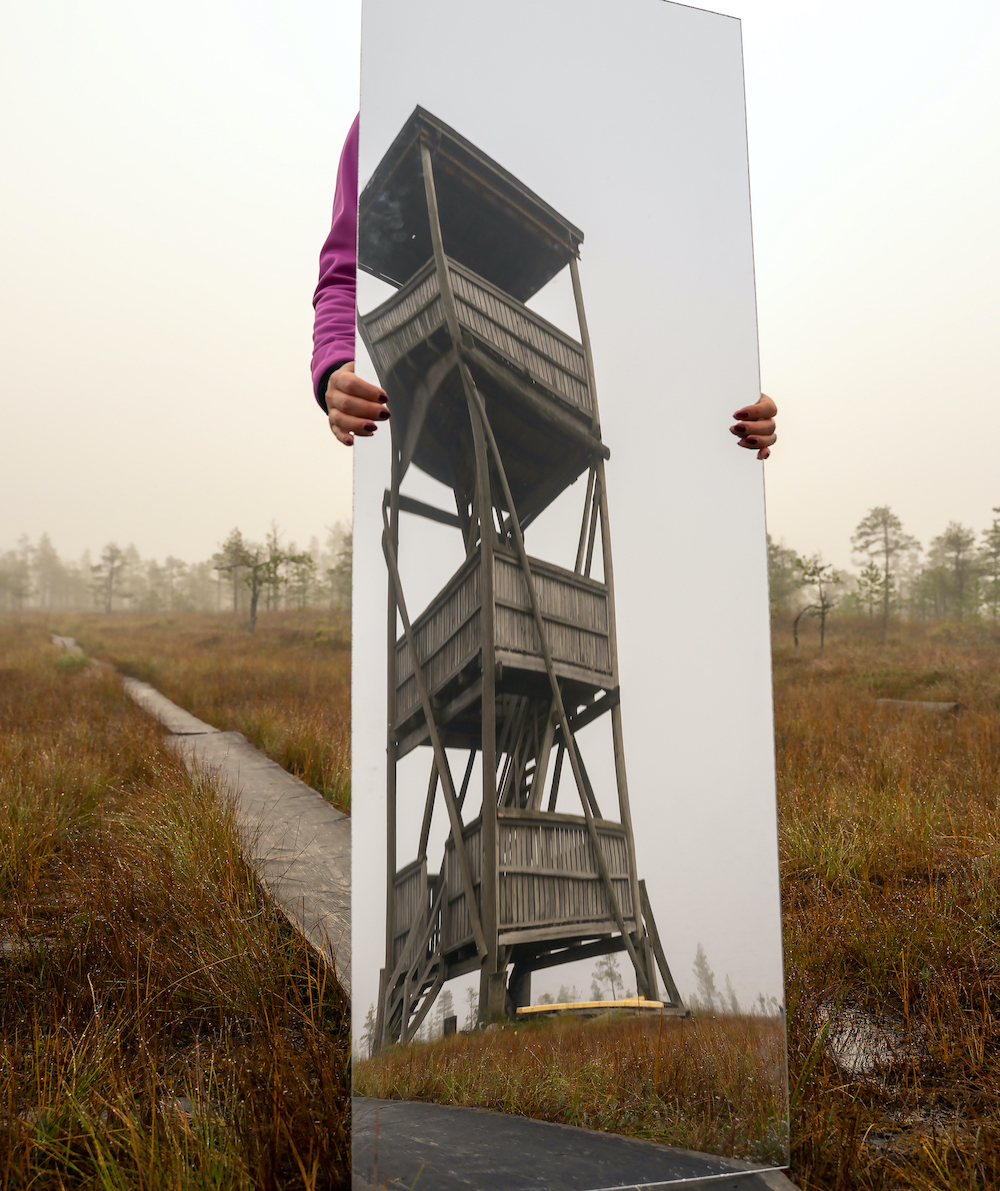 Maryna reflecting the Paukaneva bird watching tower.jpg